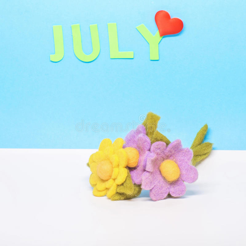 A calendar of the month of July royalty free stock photos