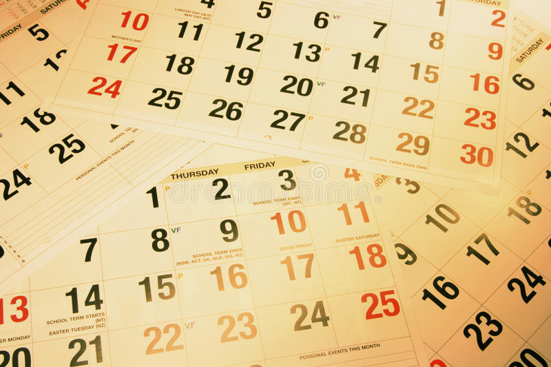 Calendar Pages. Close Up of Calendar Pages in Warm Tone stock photo