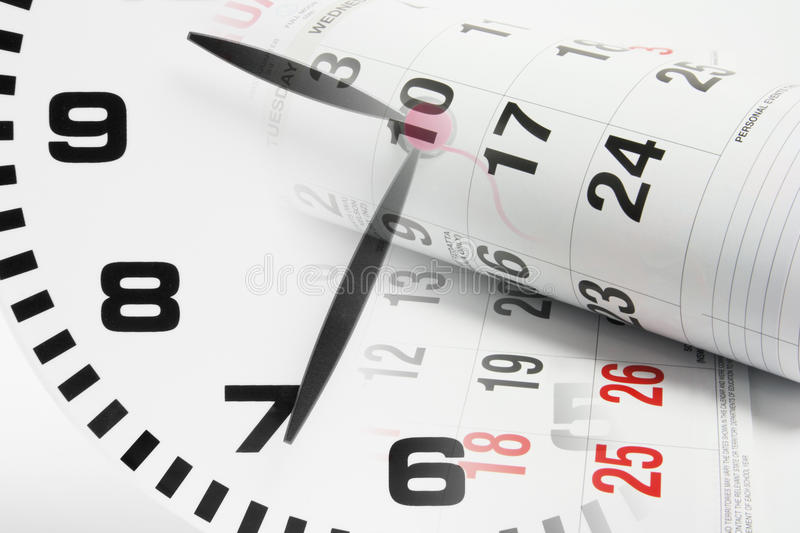 Calendar Pages and Clock. Composite of Calendar Pages and Clock stock image