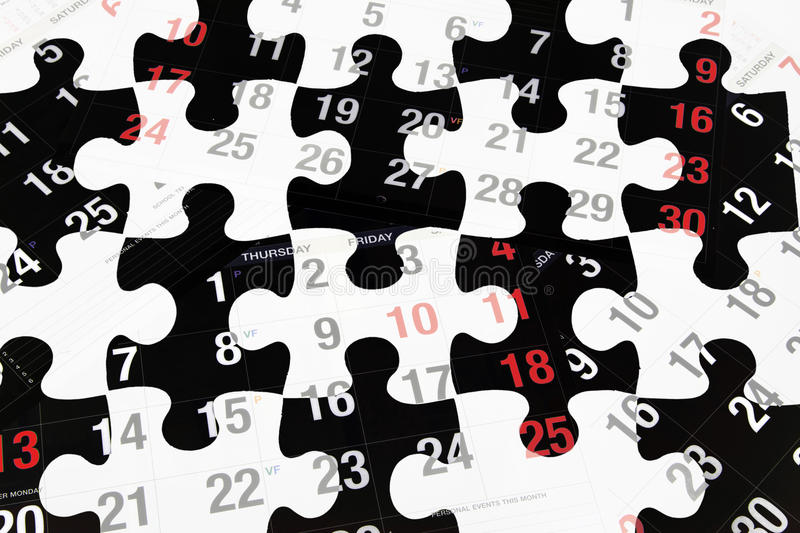 Calendar Pages and Jigsaw Puzzles. Composite of Calendar Pages and Jigsaw Puzzles royalty free stock photo