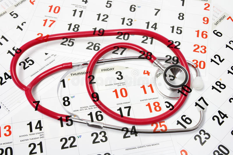Calendar Pages and Stethoscope. Composite of Calendar Pages and Stethoscope royalty free stock images