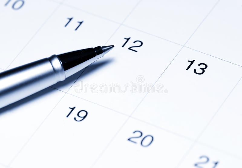 Calendar with pen stock image