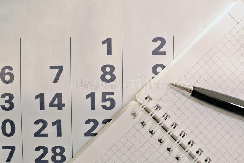 Calendar, pen and notebook with blank pages. Business and education. Calendar, pen and notebook with blank pages stock images
