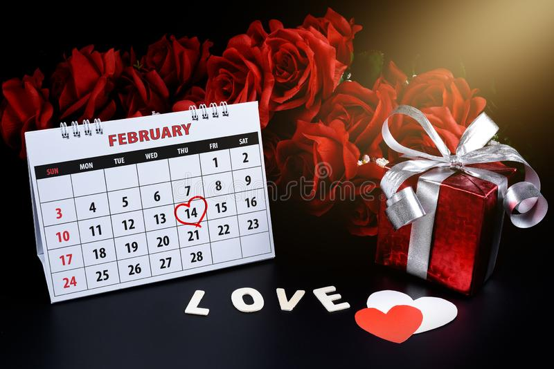 Calendar with red hand written heart highlight on February 14 of Saint Valentines day royalty free stock image