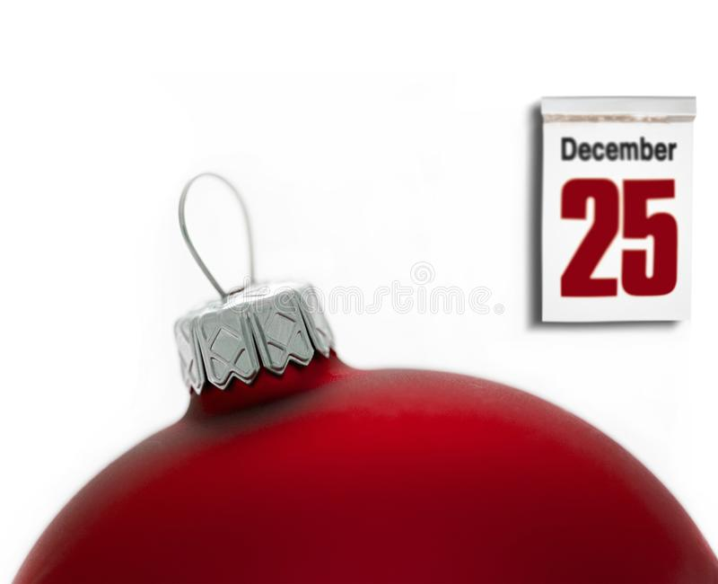 Calendar set on 25 of December with Christmas ball. Isolated royalty free stock photos