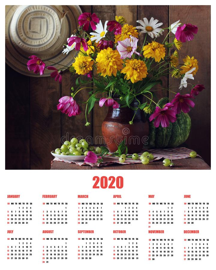 Calendar for the year 2020 with a bouquet. Rustic still life with flowers and berries. the week starts on Sunday royalty free stock image