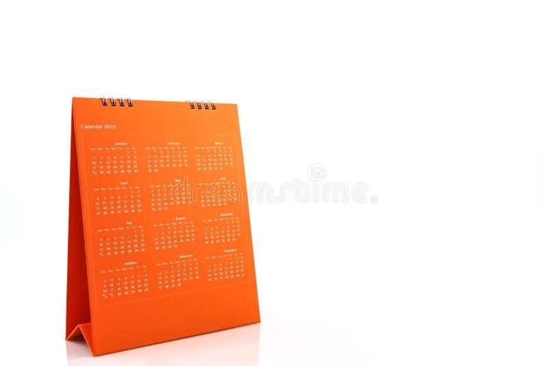 Calendario arancio 2016 di spirale dello scrittorio della carta in bianco immagine stock libera da diritti