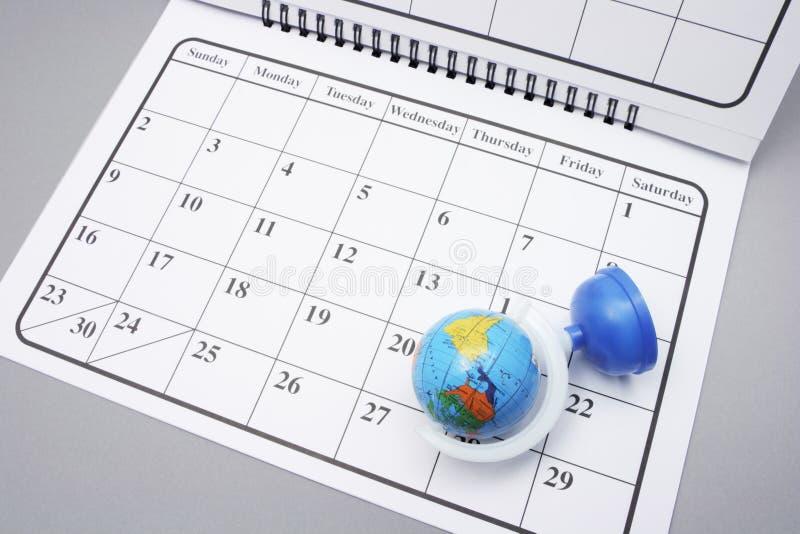 Download Calendario con il globo immagine stock. Immagine di terra - 7317977