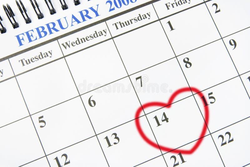 Calendario con il simbolo del cuore fotografia stock libera da diritti