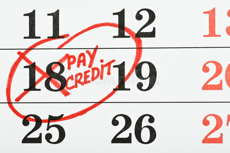 Calendario con la data del pagamento fotografia stock