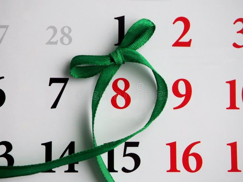 Calendario con la marca el 8 de marzo Concepto: El día de las mujeres internacionales foto de archivo