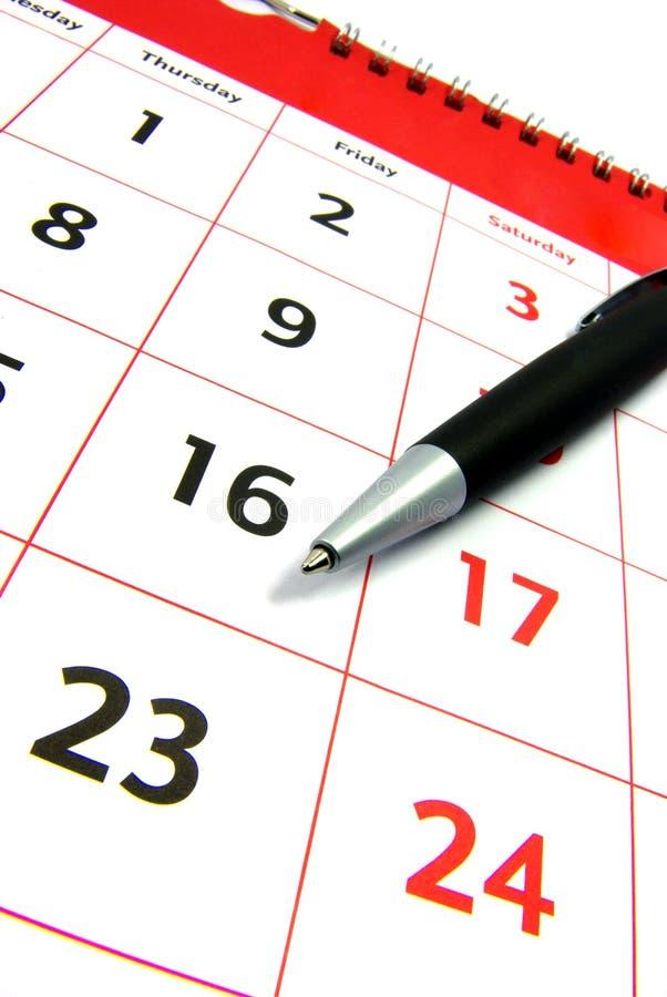 Calendario con la vista della penna fotografia stock