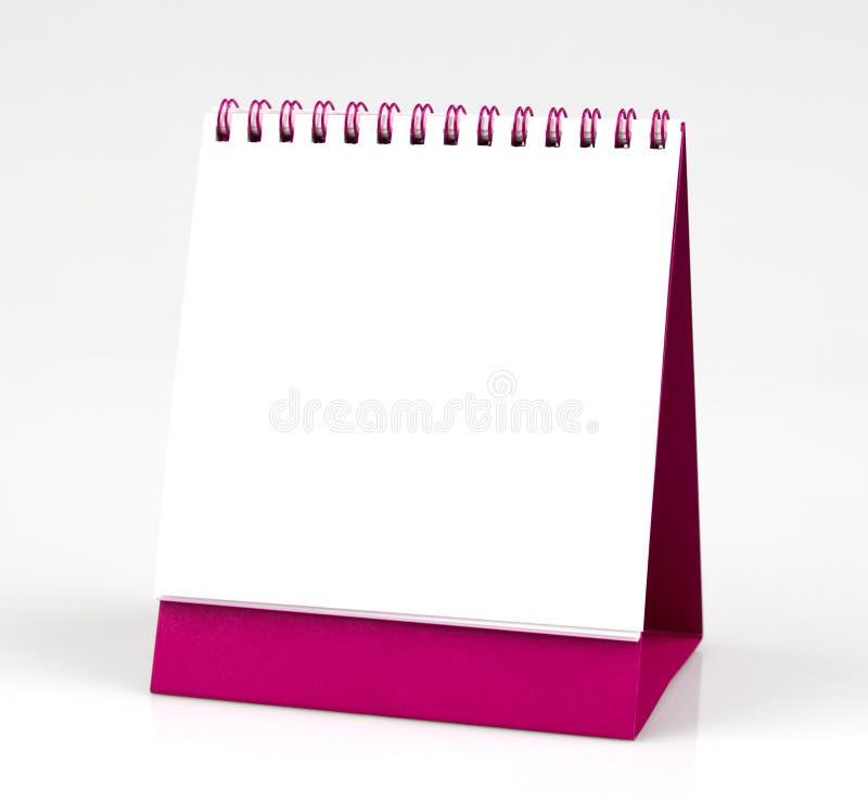 Calendario da scrivania in bianco, isolato su fondo bianco immagini stock