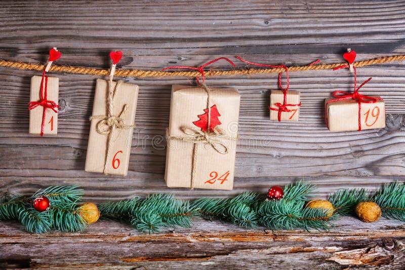 Calendario de la Navidad, regalos para el advenimiento foto de archivo libre de regalías