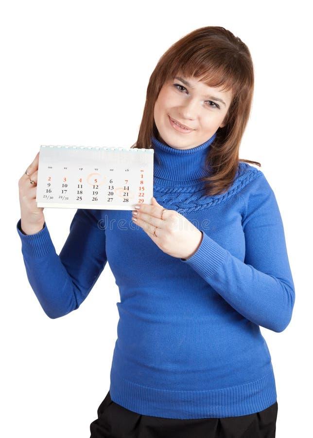 Calendario dell'a fogli mobili della holding della ragazza immagine stock