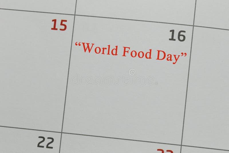 Calendario en 16 de día de comida de mundo fotos de archivo