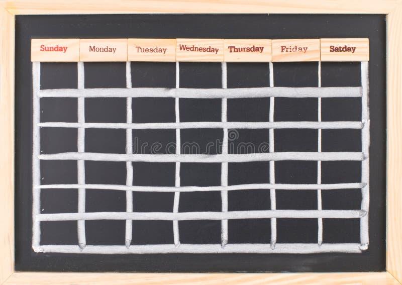 Calendario mensual con la impresión de las palabras de la semana fotos de archivo libres de regalías