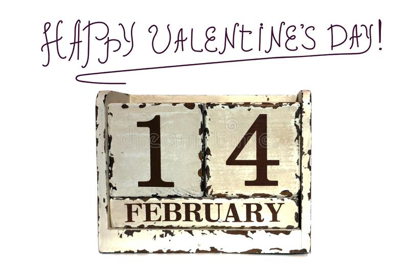 Calendrier de cube pour le 14 février sur le fond d'isolement avec la Saint-Valentin heureuse de signe, le 14 février concep images stock
