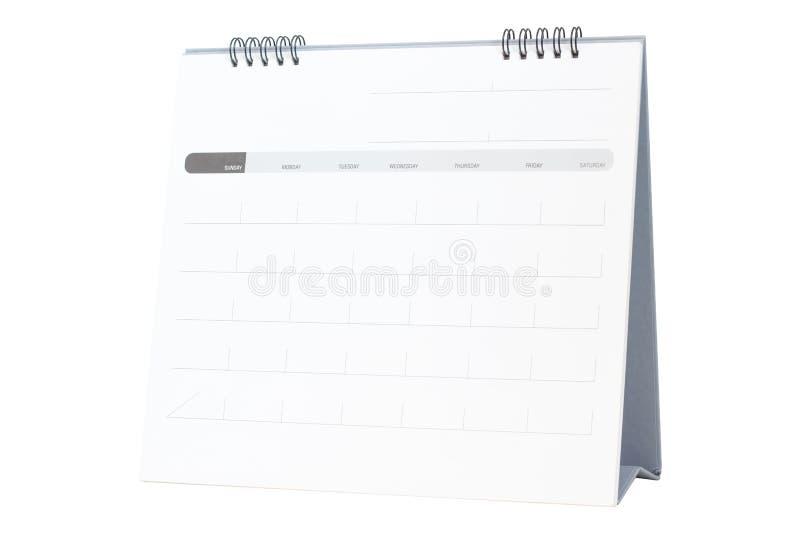Calendrier de spirale de bureau de papier blanc d'isolement sur le blanc image stock