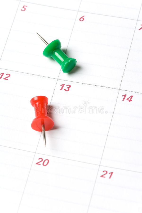 Calendrier et Thumbtack images stock