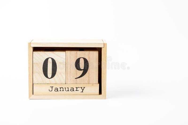 Calendrier 9 janvier en bois sur un fond blanc images libres de droits