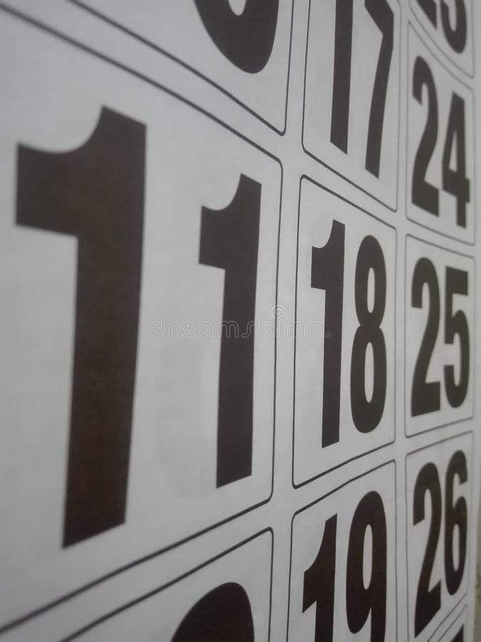 Calendrier jour après jour avec de grandes lettres noires photographie stock