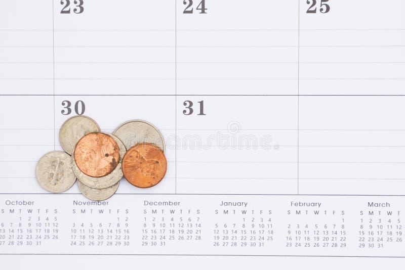 Calendrier mensuel avec des pièces de monnaie des Etats-Unis photos stock