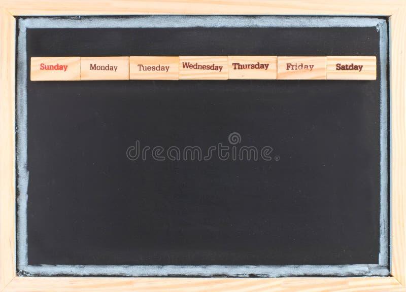 Calendrier mensuel avec l'impression de mots de semaine images stock