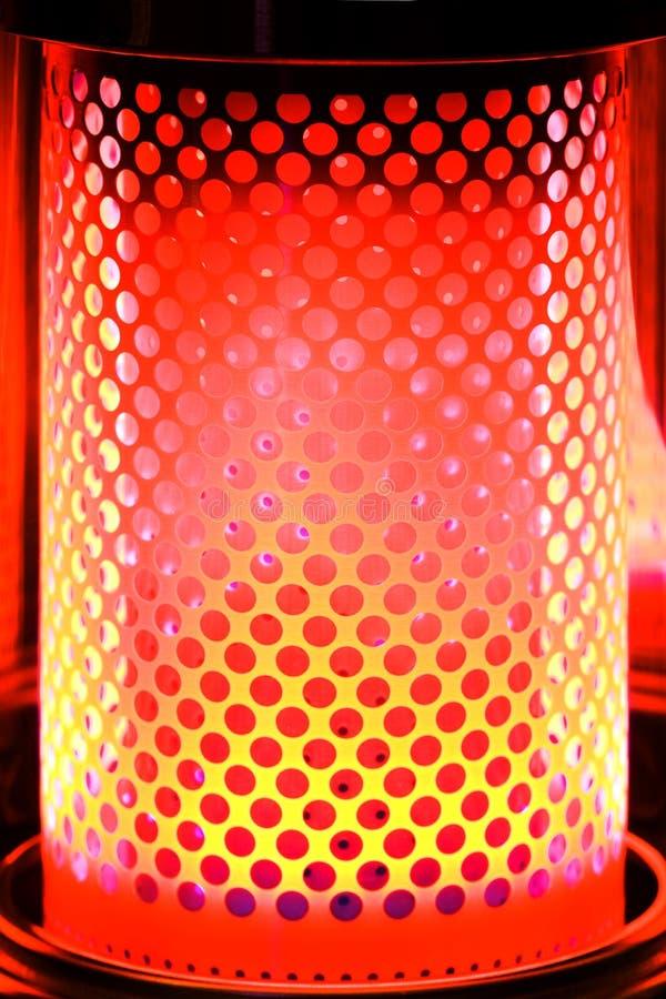 Calentador de la parafina con tono naranja rojo imagen de archivo libre de regalías