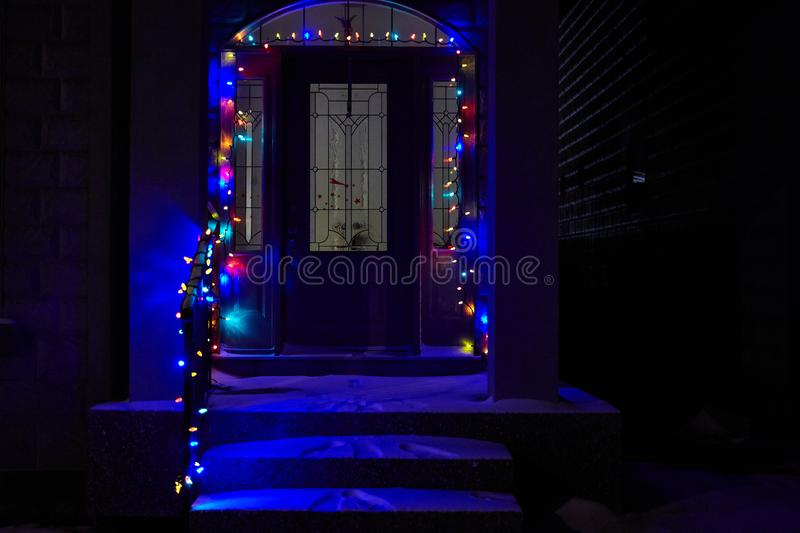 CALGARY CANADA - December 01, 2012 - House porch with snow decorated with christmas lights for a holiday season stock images