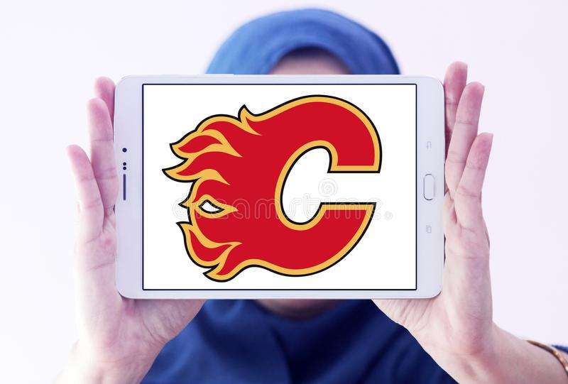 Calgary Flames ice hockey team logo. Logo of Calgary Flames ice hockey team on samsung tablet holded by arab muslim woman. The Calgary Flames are a professional stock images