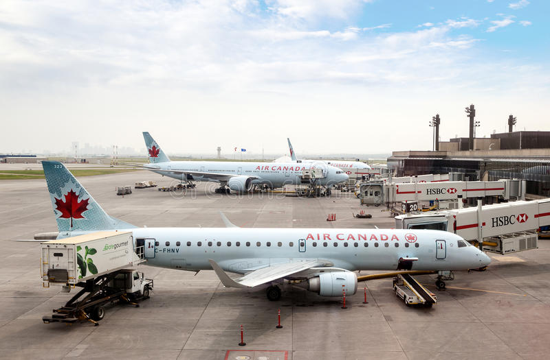 Calgary International Airport Tarmac. Air Canada commercial planes being serviced on the tarmac of Calgary International Airport. Opened in 1938, the airport stock photos