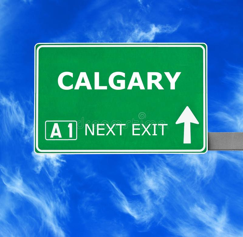 CALGARY road sign against clear blue sky stock images