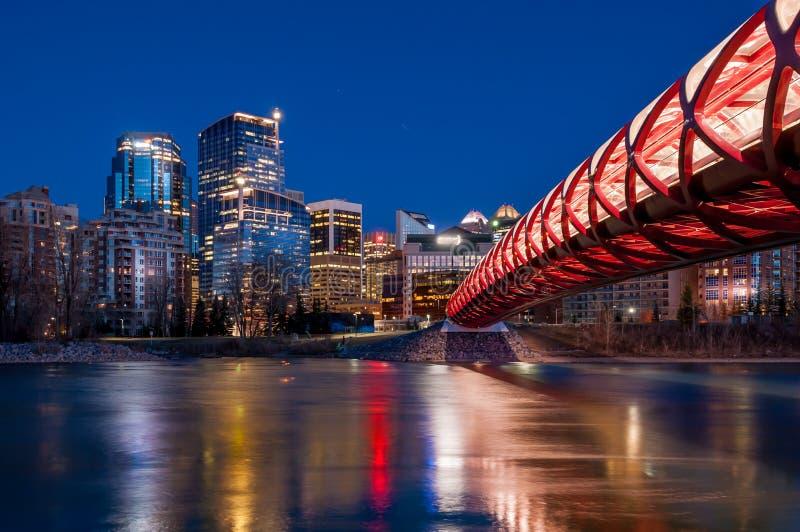Calgary's Peace Bridge and skyline at night stock images