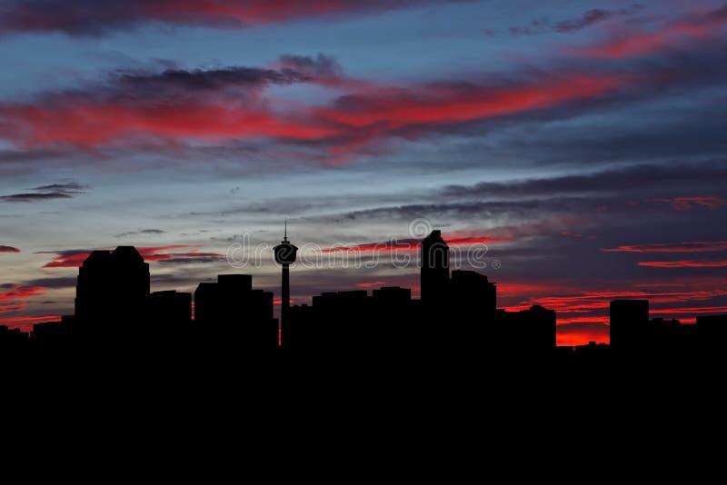 Calgary skyline vid solnedgångsillustration royaltyfria bilder
