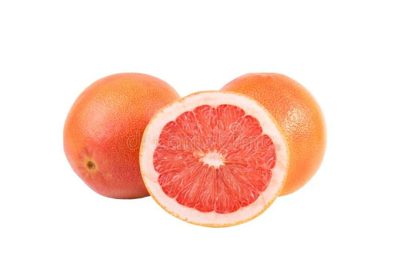 Cali grapefruits i połówka odizolowywająca Dojrzała owoc obraz royalty free