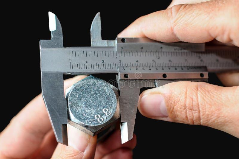 Calibración de un perno de acero fotografía de archivo libre de regalías