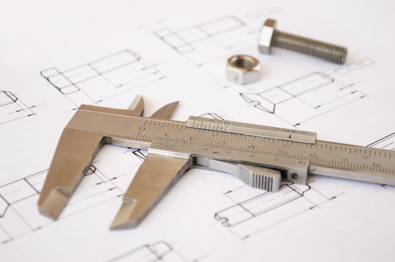 Calibrador de acero con los aviones imagen de archivo