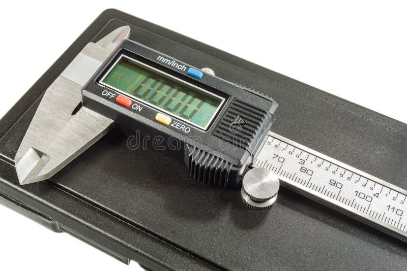Calibrador de Digitaces con la caja de almacenamiento en un fondo blanco fotos de archivo libres de regalías