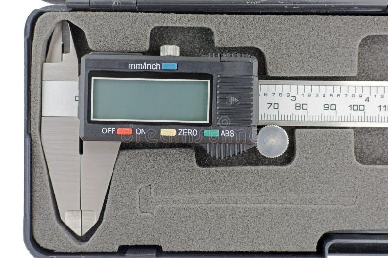 Calibrador de Digitaces en la caja negra aislada en blanco fotografía de archivo