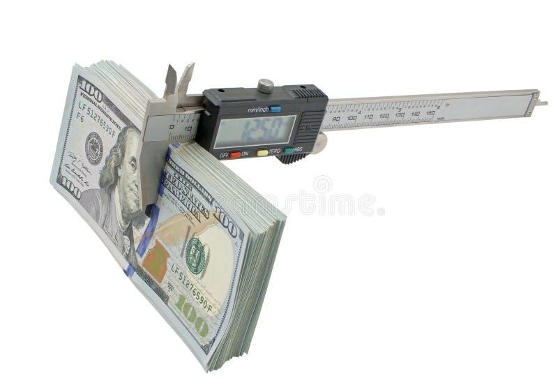 Calibrador a vernier y pila de billetes de dólar de $ 100 fotos de archivo