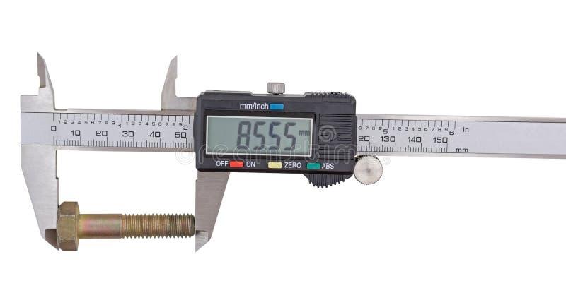 Calibrador a vernier y tornillo-perno en un blanco fotografía de archivo