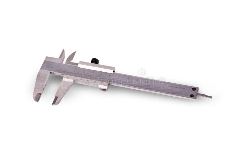Calibrador viejo del metal en el fondo blanco foto de archivo libre de regalías