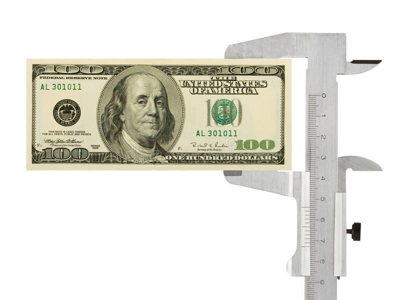 Calibrador y dinero imagenes de archivo