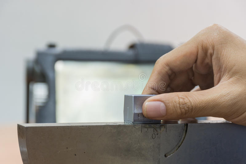 Calibration angle probe of Ultrasonic scan with standard steel b. Calibration angle probe of Ultrasonic scan with standard block stock photos