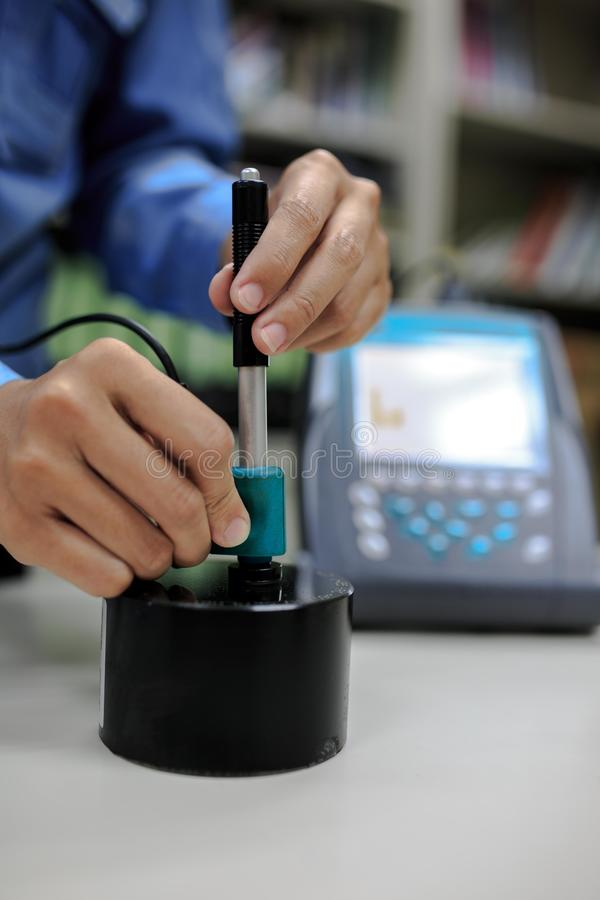 Calibration digital hardness tester with standard block. Calibration digital hardness tester with standard hardness block royalty free stock image