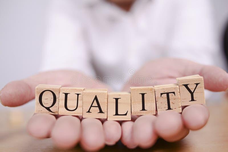 Calidad, citas inspiradas de motivación de la ética empresarial imagenes de archivo