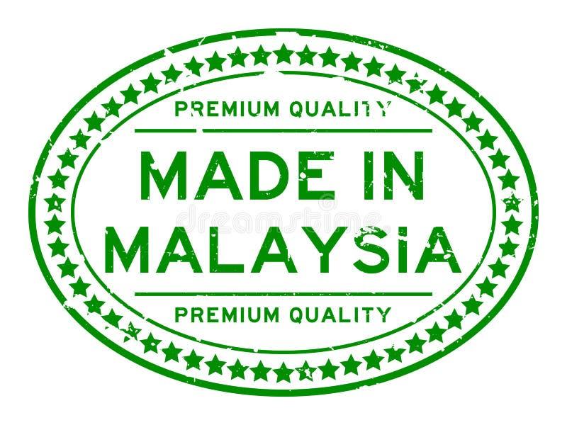 Calidad del premiumq del verde del Grunge hecha en sello de negocio de goma oval de Malasia en el fondo blanco stock de ilustración