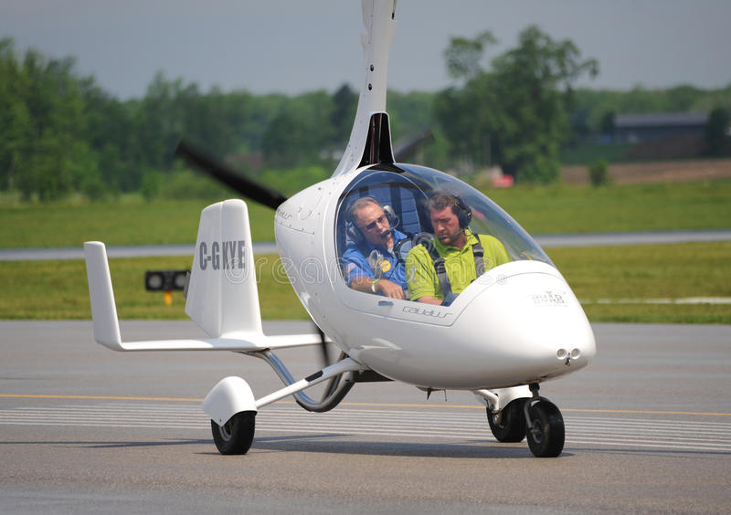 Calidus gyroplane on Waterloo Airshow, Ontario, Canada. June, 2013 - Auto-Gyro dealer in Canada gives the demonstration flight in Waterloo Airport (CYKF) stock photo