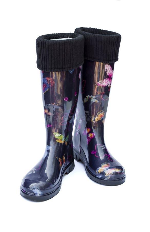 Caliente las botas de goma femeninas negras aisladas en el fondo blanco imágenes de archivo libres de regalías
